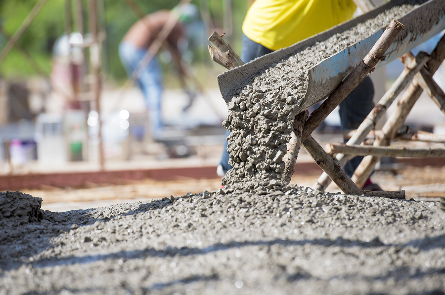 professional concrete services expert working on concrete pouring