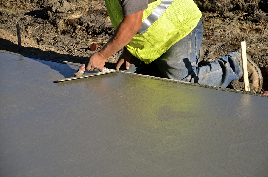 professional concrete contractor working on concrete polishing