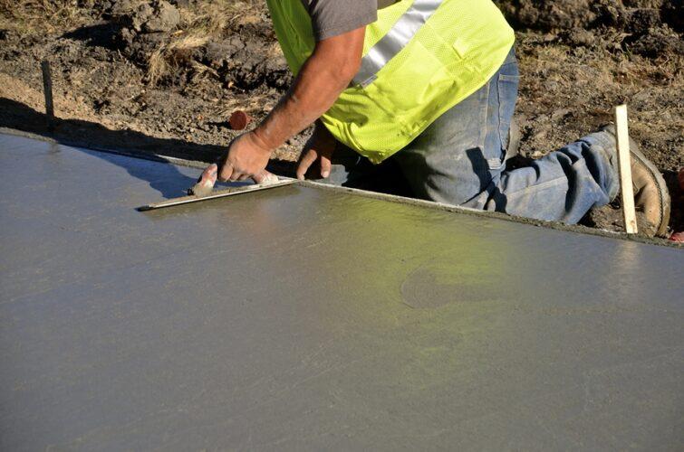 professional concrete services expert working on concrete repair