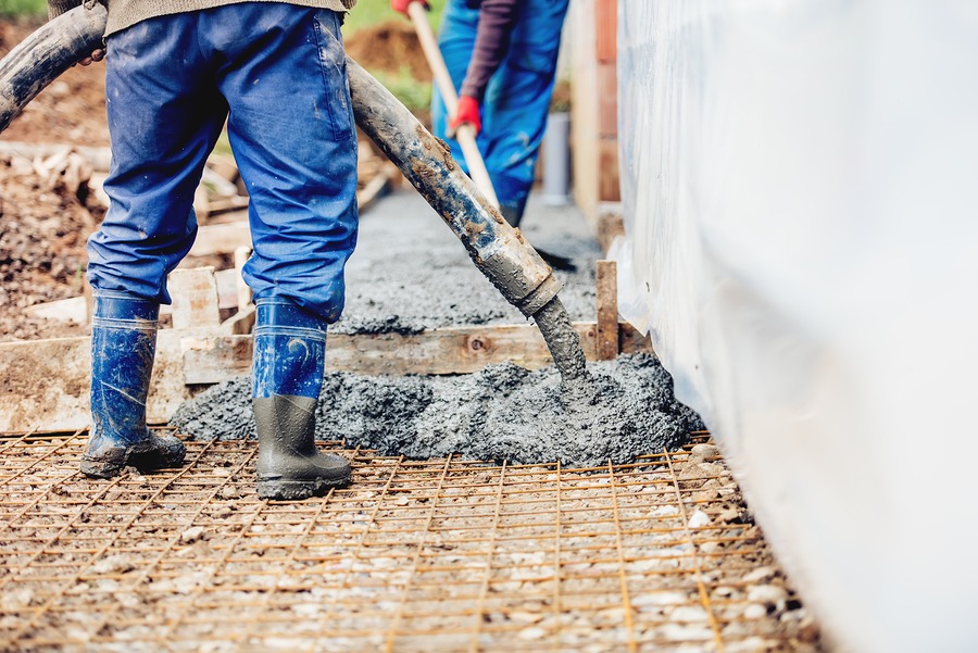 professional concrete services expert working on repair
