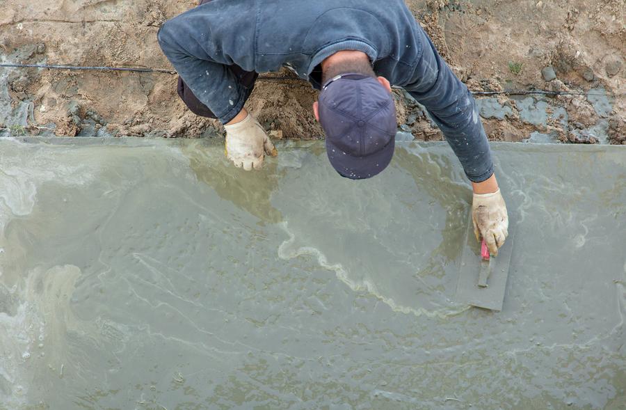 professional concrete services expert working on decorative concrete
