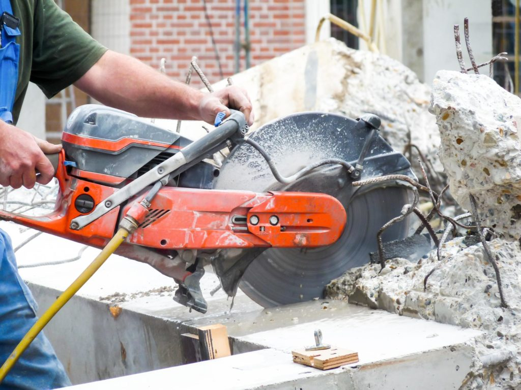 professional concrete services expert working on demolition and excavation