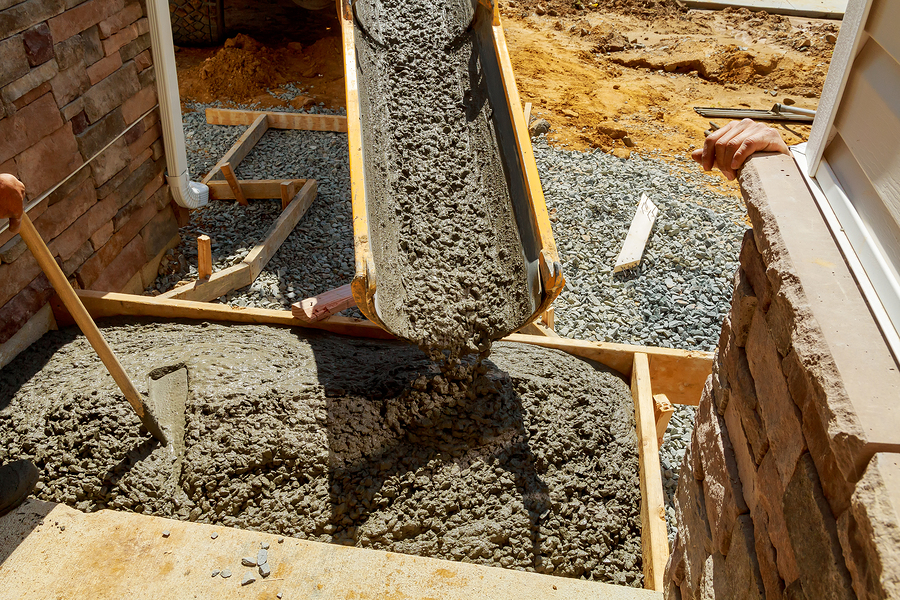 professional concrete services expert working on foundation and wall