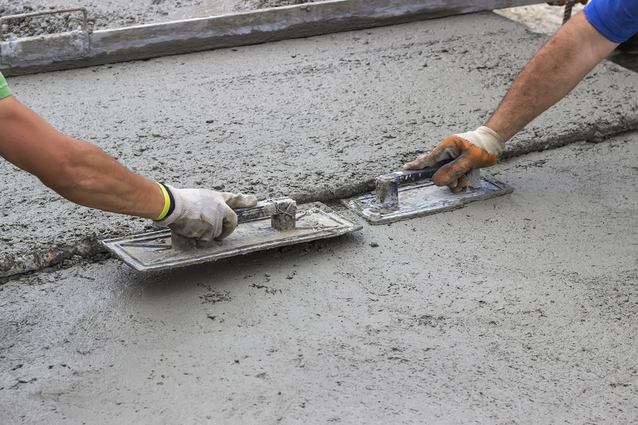 professional concrete services expert working on residential project